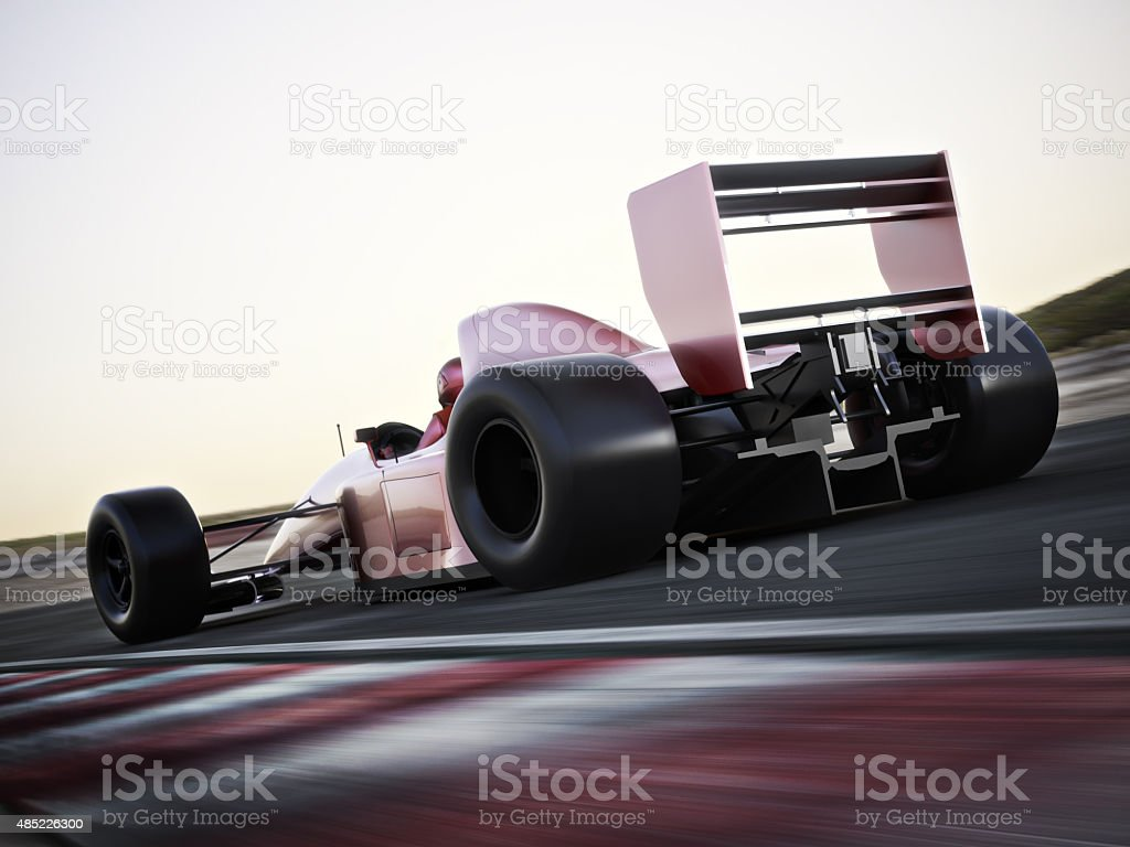 Race car back view speeding down a track stock photo