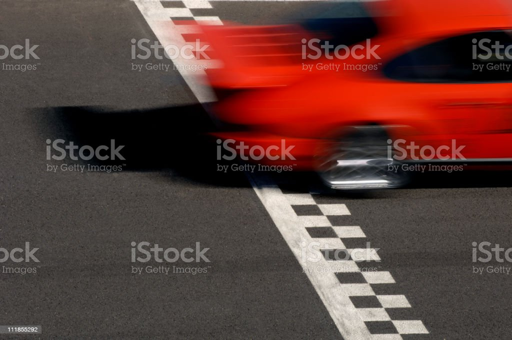 Race Car Crossing Checkered Finish Line stock photo