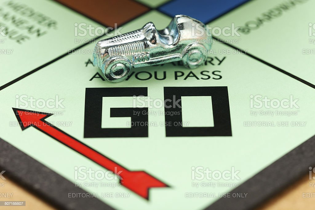 Race Car Piece On A Monopoly Board stock photo