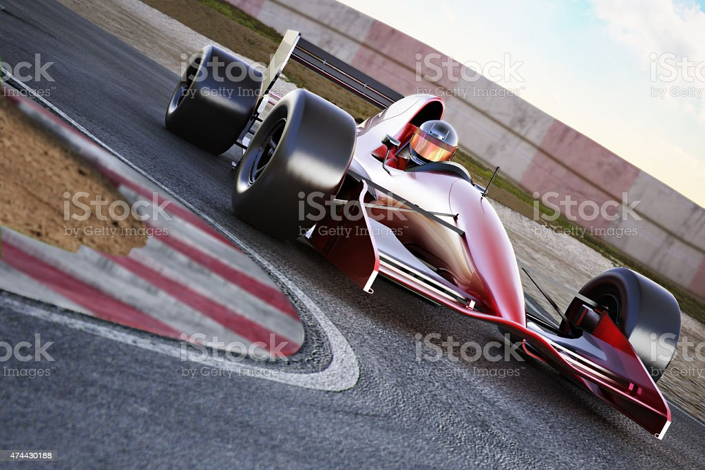 Race car racing into a turn stock photo