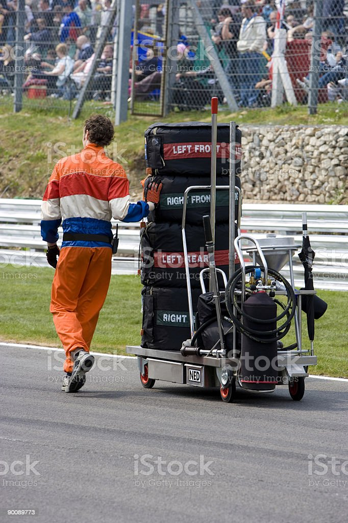 Race mechanic taking tyres to the grid royalty-free stock photo