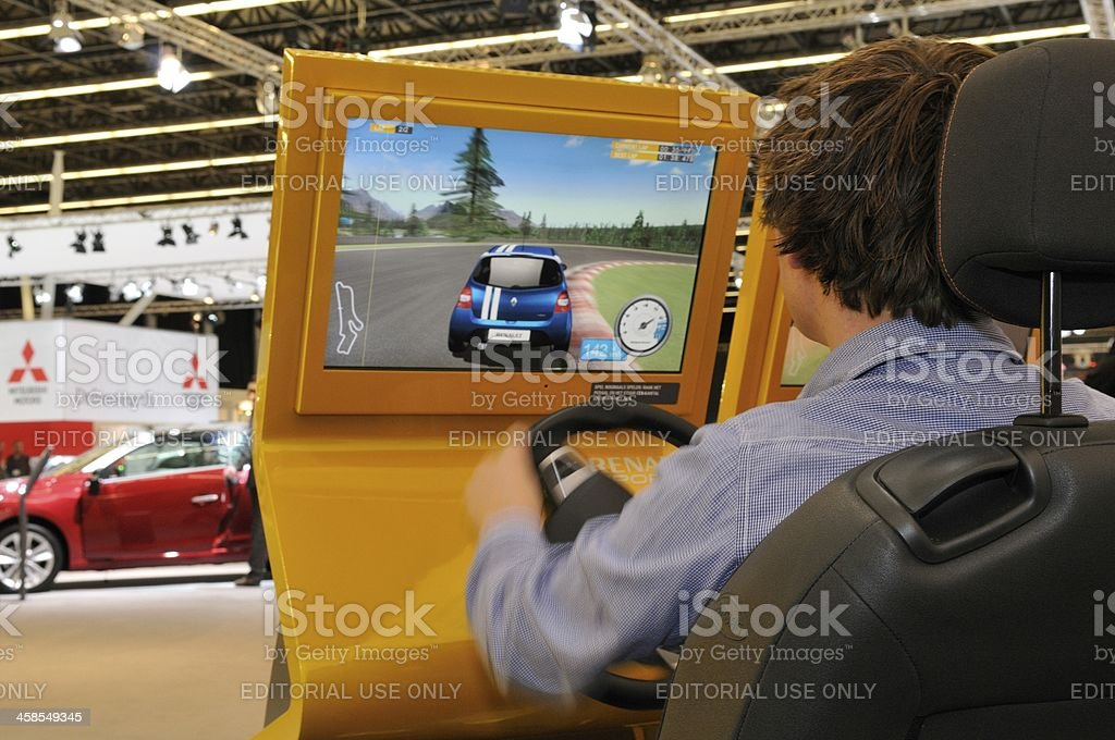 Race simulator with a man playing a racing computer game stock photo