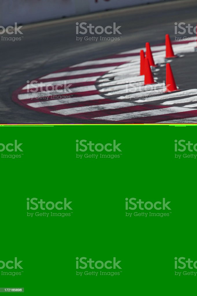 Race track corner with cones and curbing stock photo