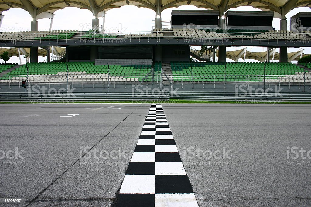 Race track finish line with empty seats stock photo