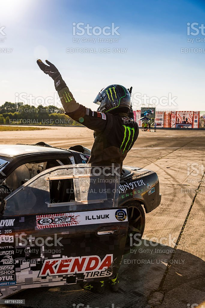 Racer Dmytro Illyuk welcomes visitors stock photo
