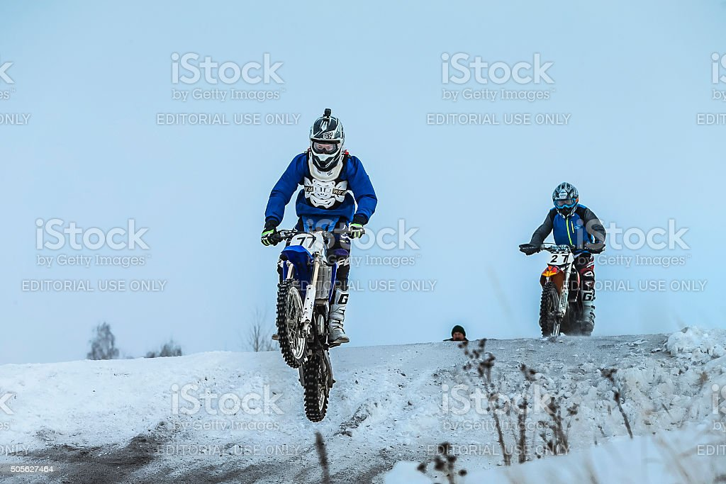 racer man on motorcycle flying over mountain after jump stock photo