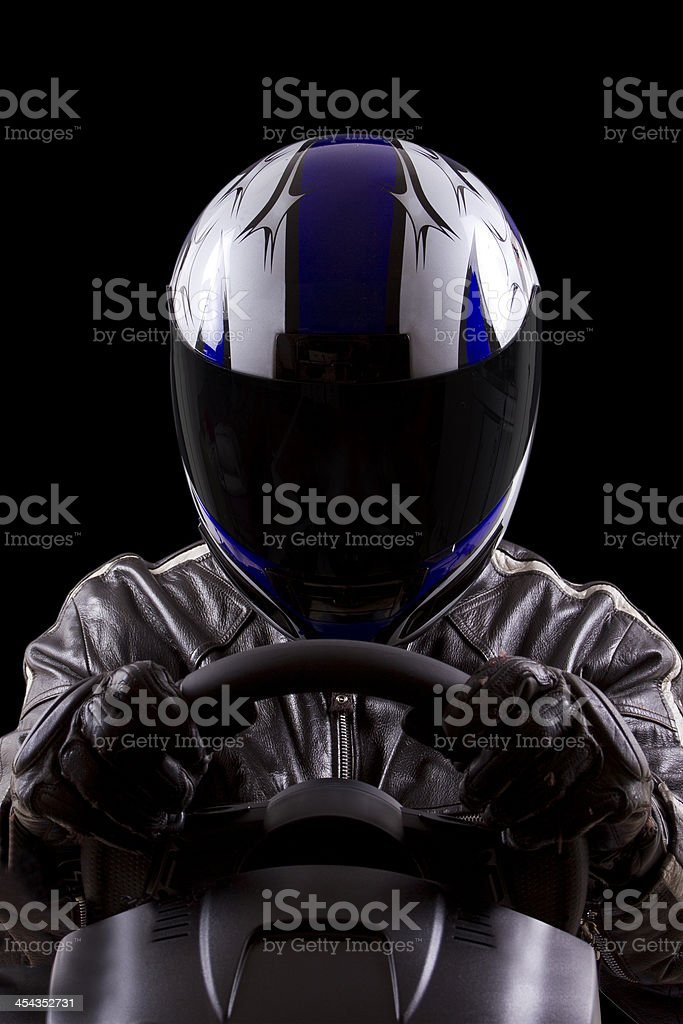 Racer Wearing a Helmet and Leather Protective Gear stock photo