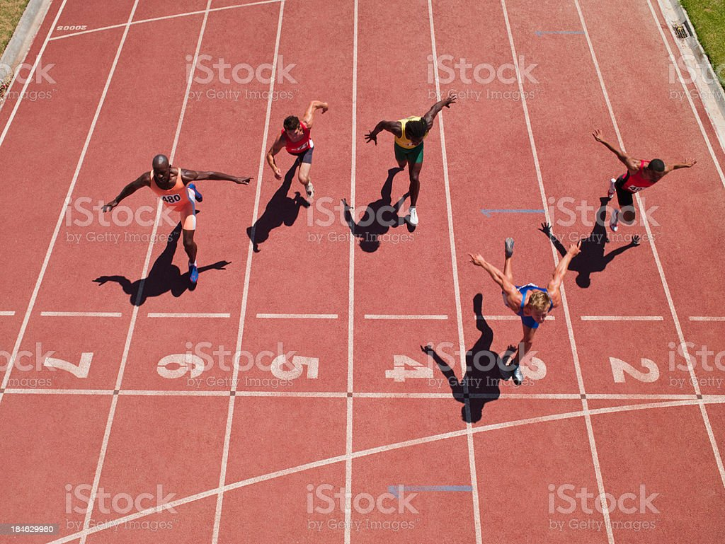 Racers at the start line on a track stock photo
