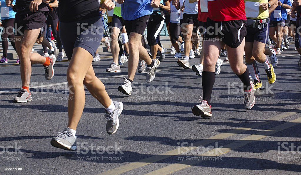 Racers frozen in time during a marathon stock photo