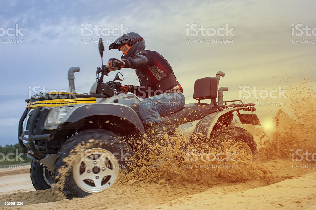 Racing ATV in the sand stock photo