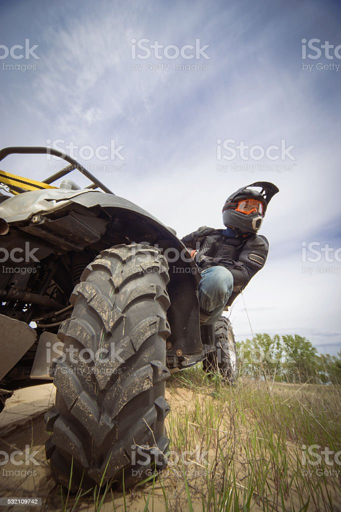 Racing ATV in the sand . stock photo