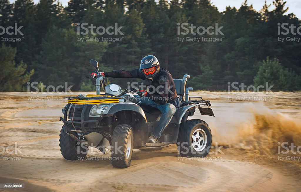 Racing ATV in the sand. stock photo