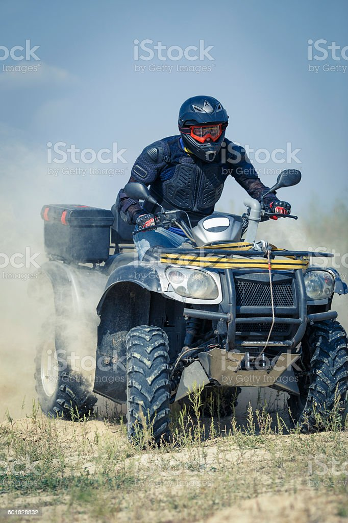 Racing atv is sand. stock photo