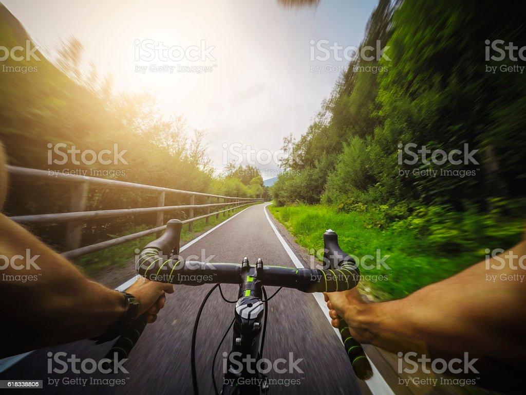 Racing bicycle POV riding stock photo
