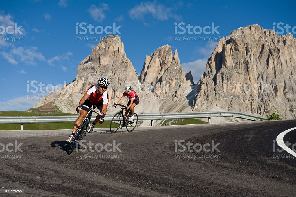 two cyclists with race bikes in downhill