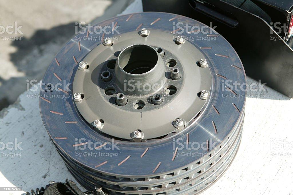 Racing car disc brakes on pit lane wall stock photo