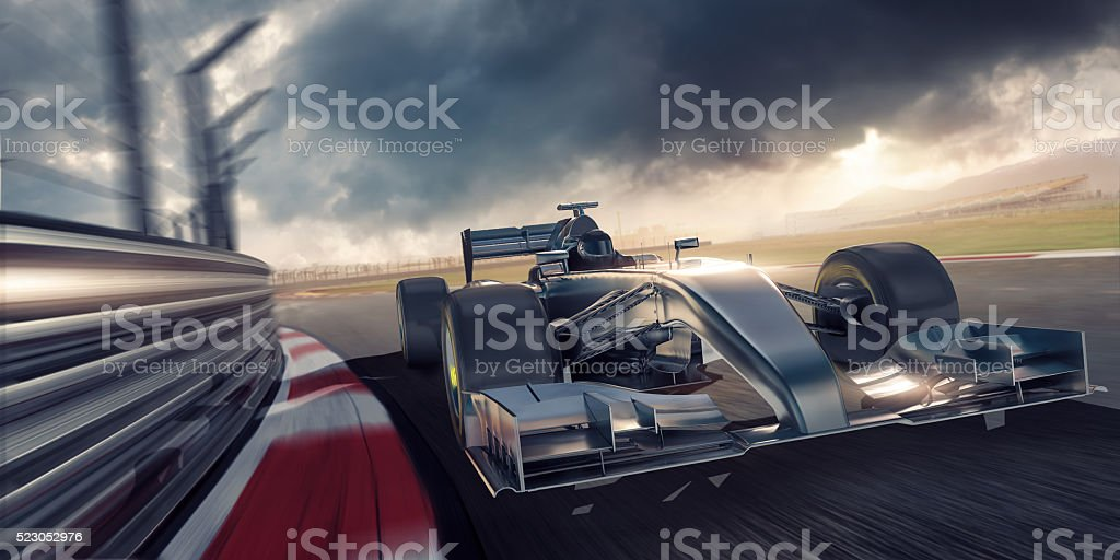 Racing Car During Race on Track At Sunset stock photo