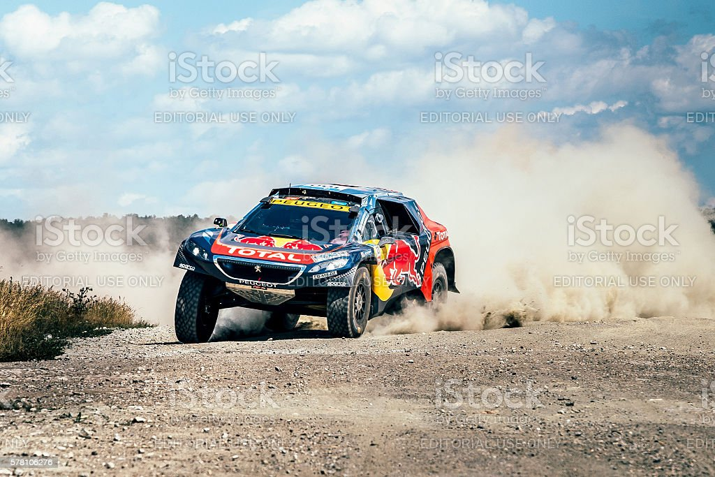 racing car Peugeot driving on a dusty road stock photo