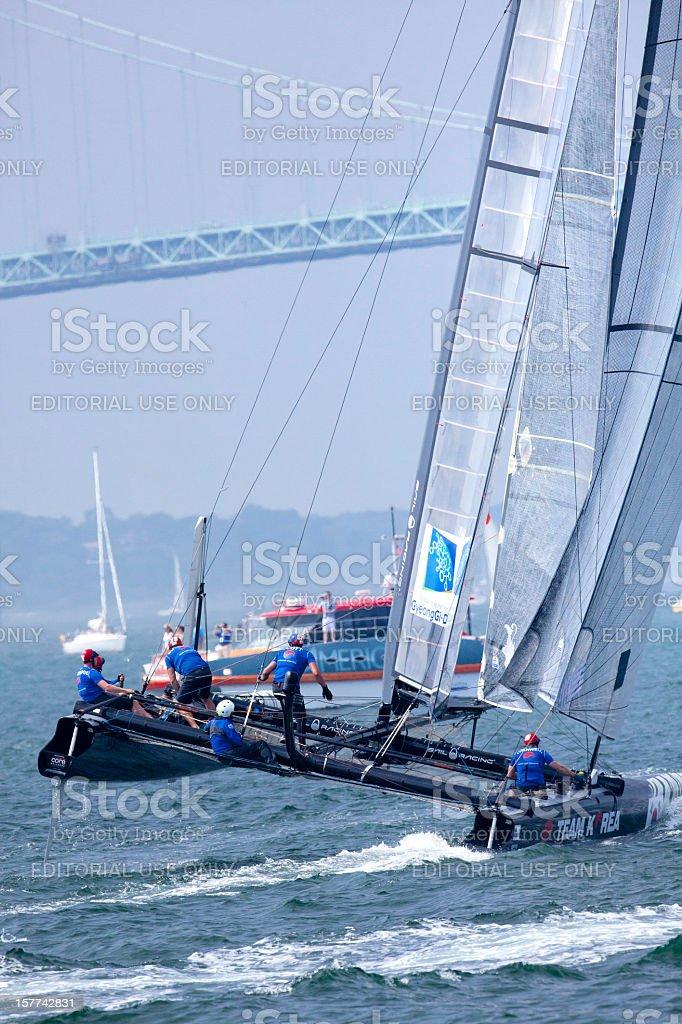 Racing  Catamaran Yacht in a  Balancing Maneuve stock photo