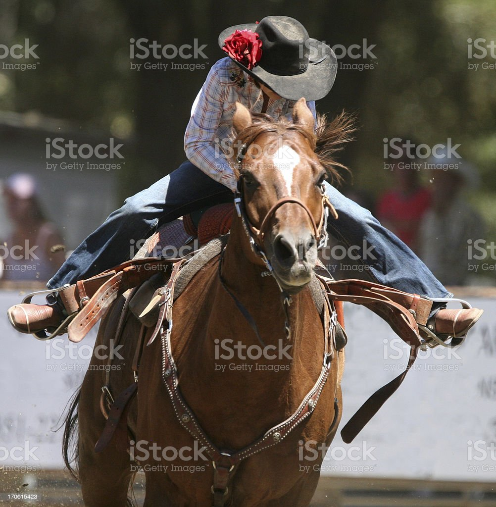 Racing Cowgirl stock photo