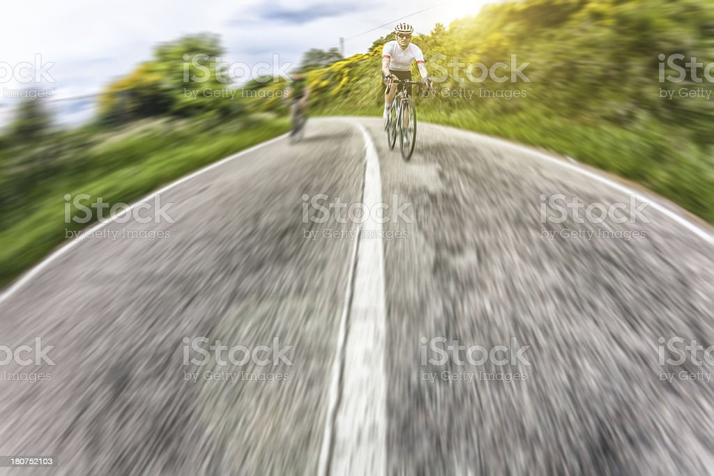 Racing Cyclist at High Speed Running for Victory royalty-free stock photo