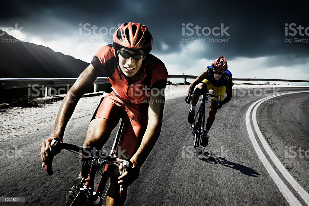 Racing cyclists on road stock photo