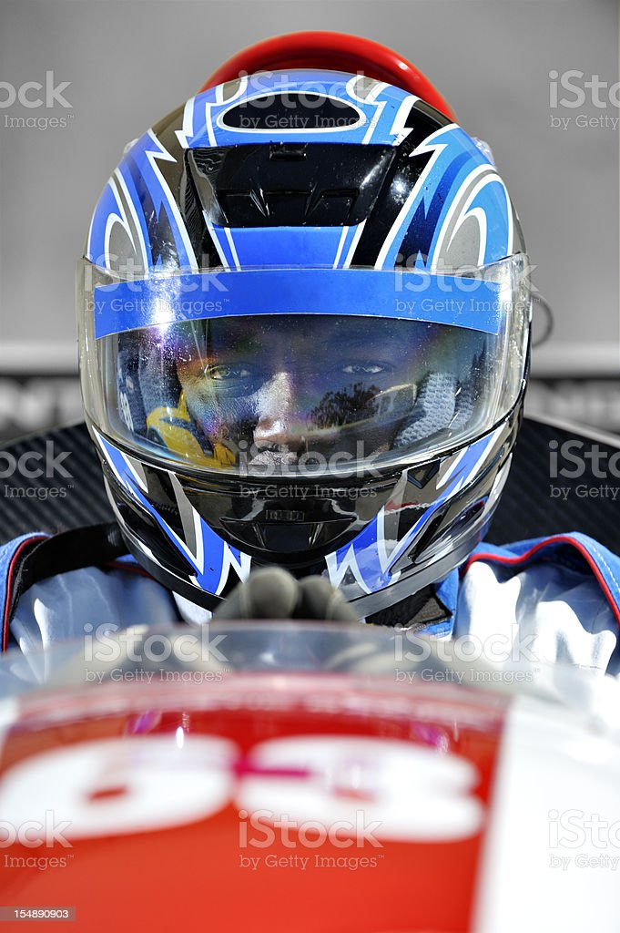 Racing driver concentrating stock photo