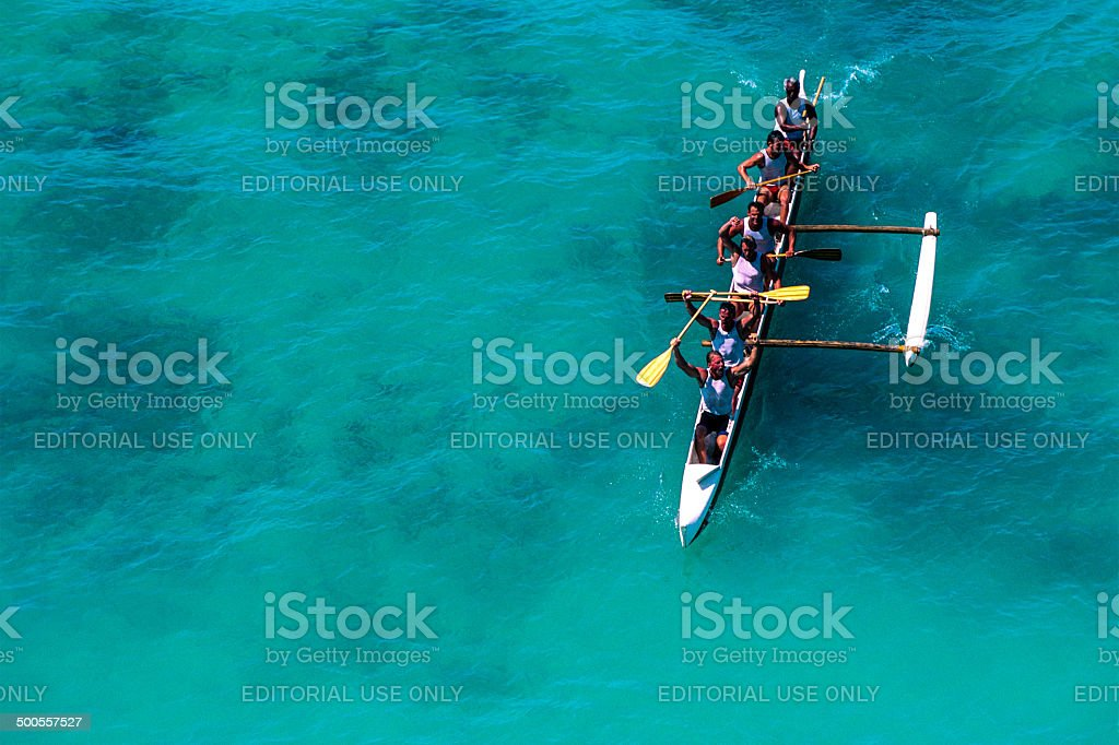 Racing outrigger canoe stock photo