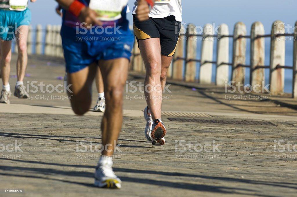 Racing road runners stock photo