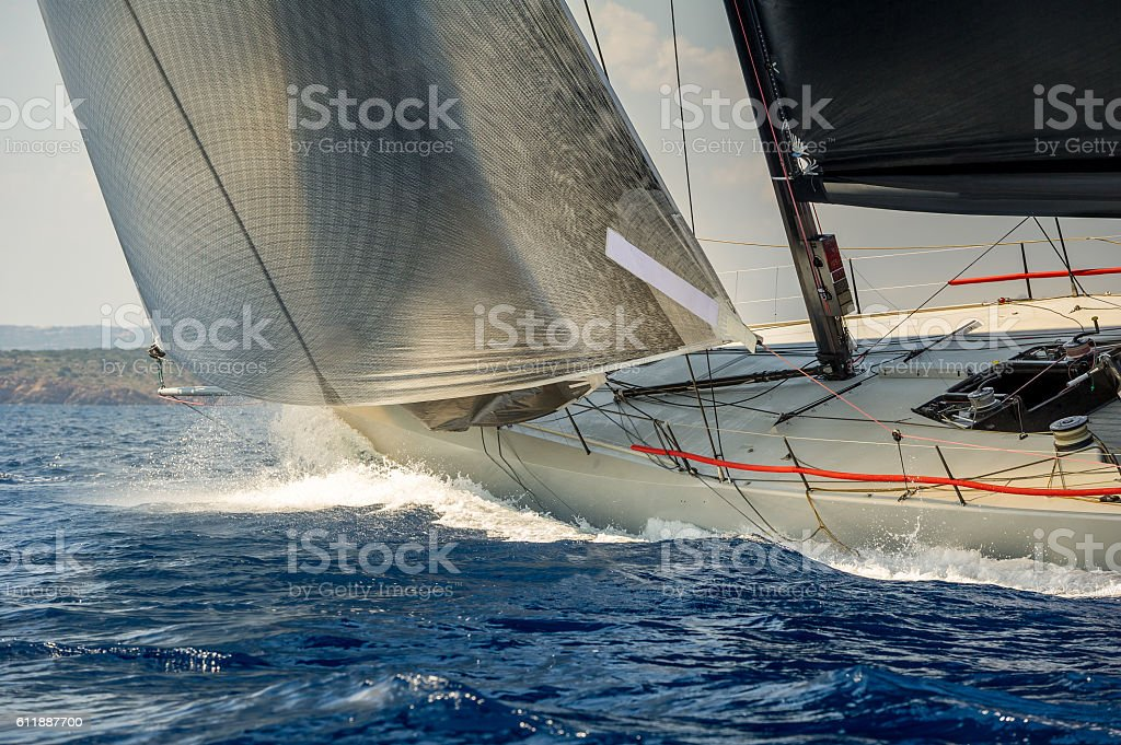 Racing sailing yacht going fast in the Mediterranean sea stock photo
