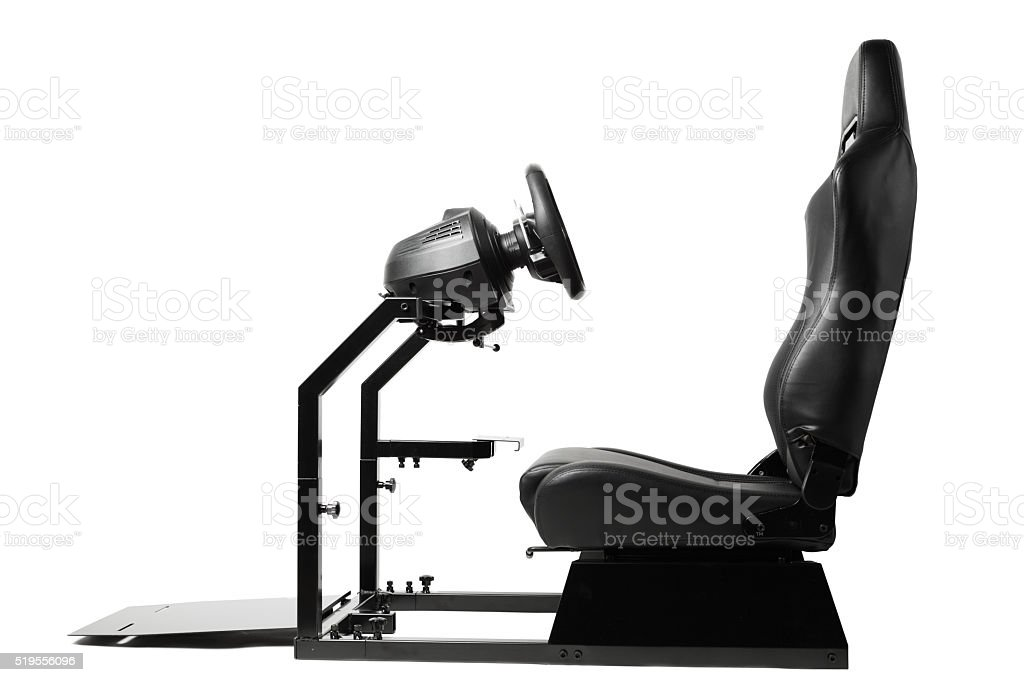 racing simulator cockpit with seat and wheel stock photo
