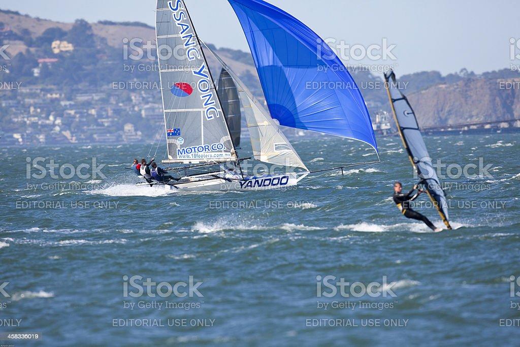 Racing Skiff and Windsurfer royalty-free stock photo