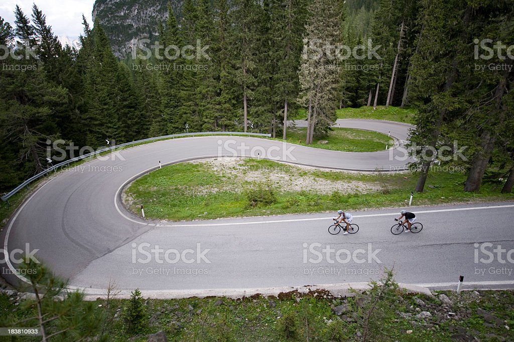 Racing team at a winding downhill stock photo