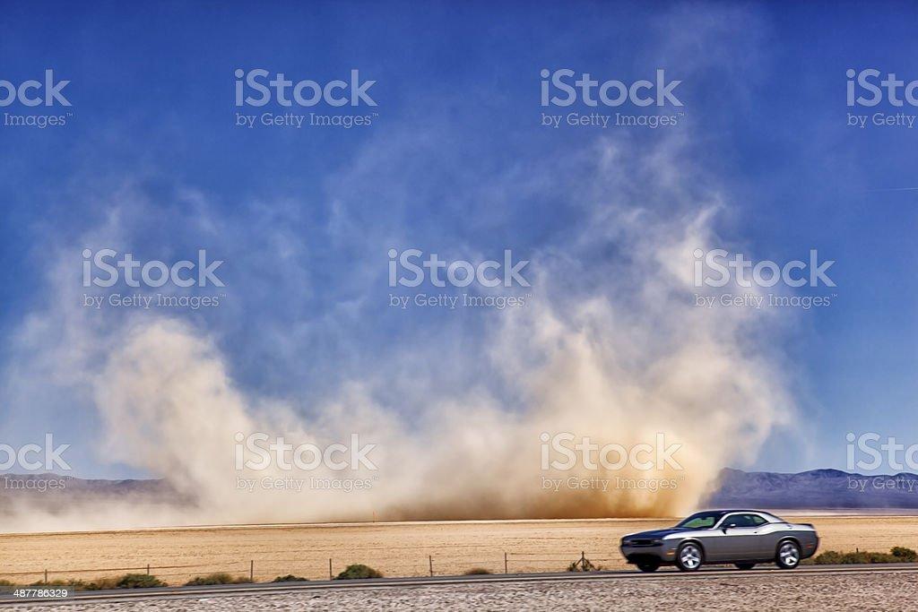 Racing the Dust Devil stock photo