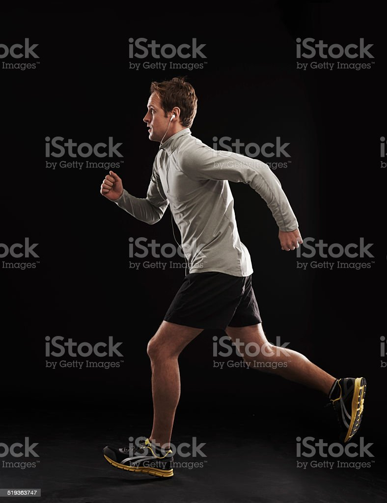 Racing toward his fitness goals stock photo