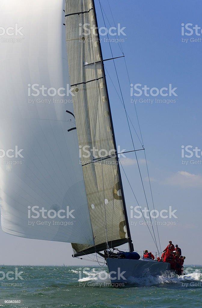 Racing Yacht Sail Boat With White Sails stock photo