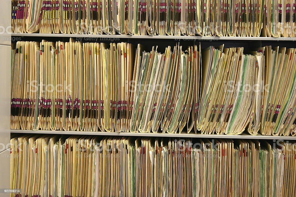 Rack full of old medical records stock photo