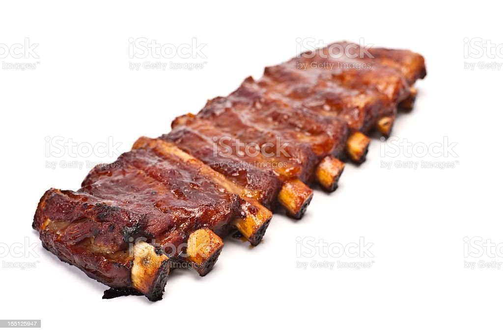 Rack of barbecue pork ribs on a white background stock photo