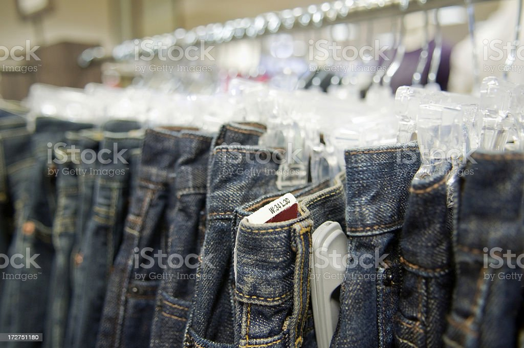 Rack of Blue Jeans at Department Store royalty-free stock photo