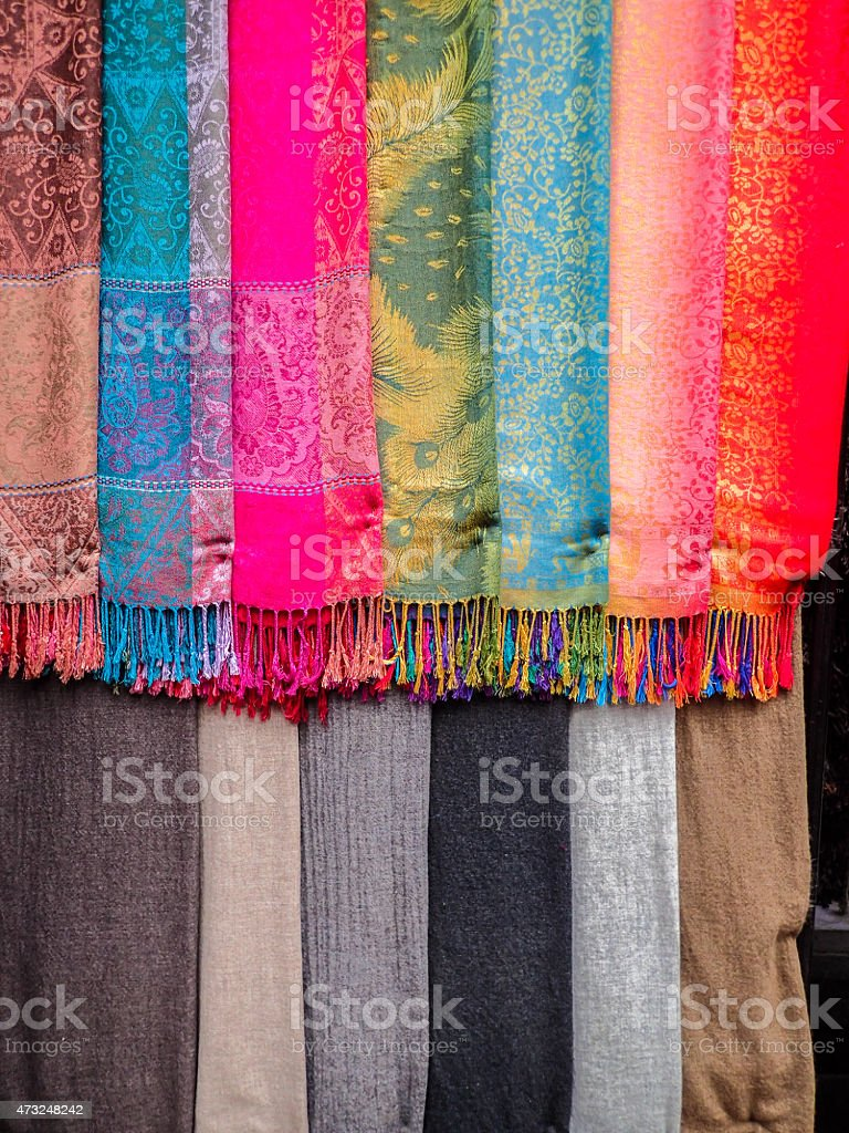 Rack of brightly colored scarves stock photo