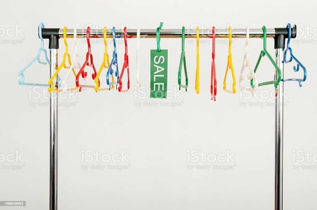 Rack of clothes with empty hangers and a sale sign. royalty-free stock photo