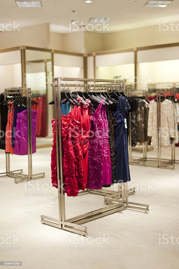 A rack of designer formal dresses in a high-end boutique. royalty-free stock photo