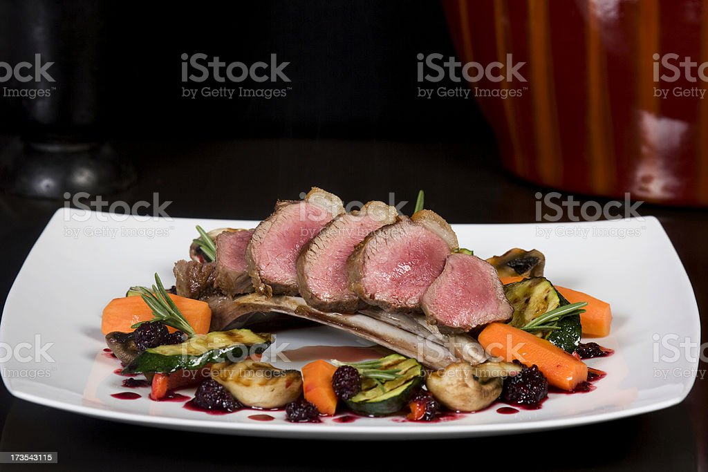 Rack of Irish spring lamb cooked pink stock photo