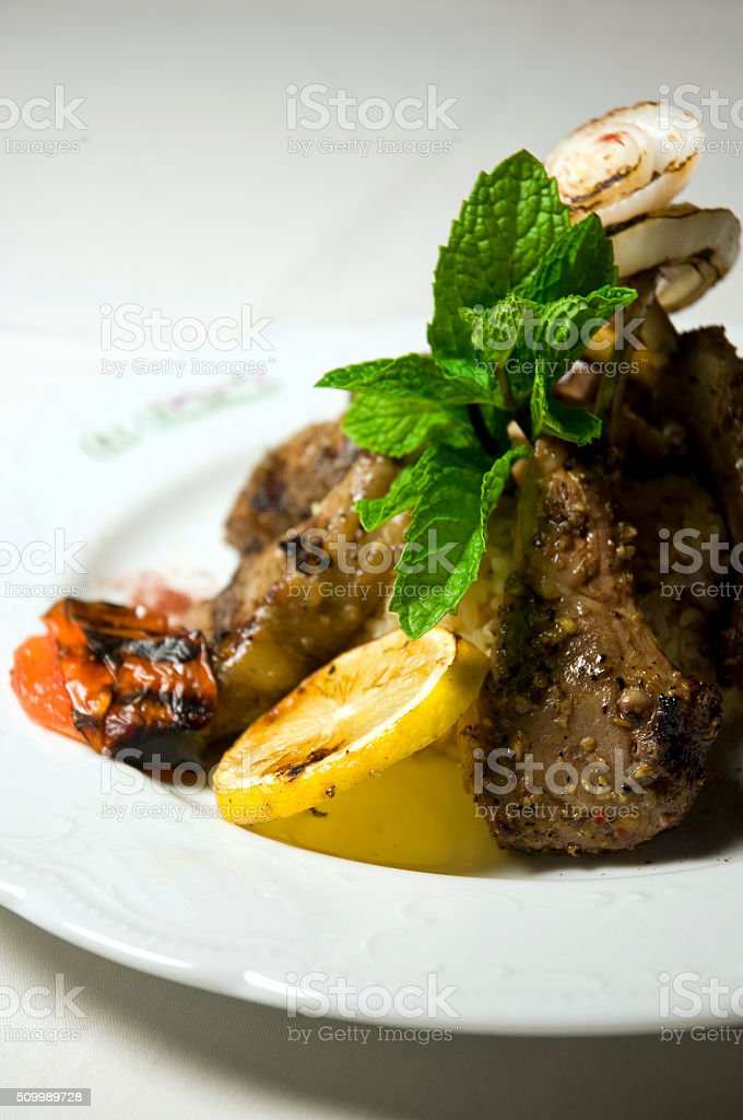Rack Of Lamb Gourmet Dinner With Mint Leaf Macro stock photo