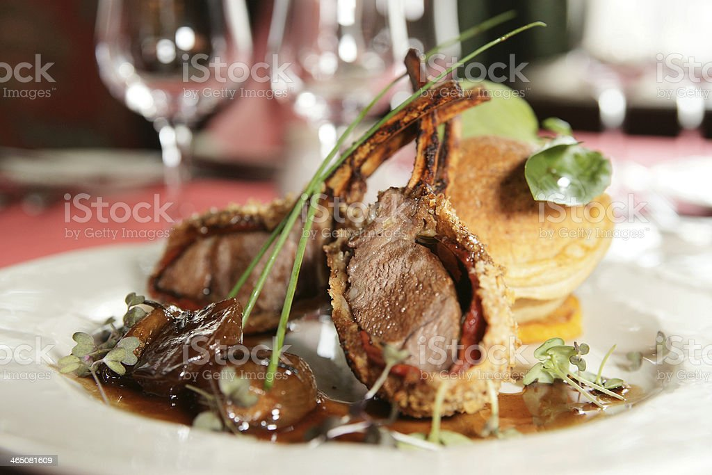 Rack of lamb with caramelized onions and bread stock photo