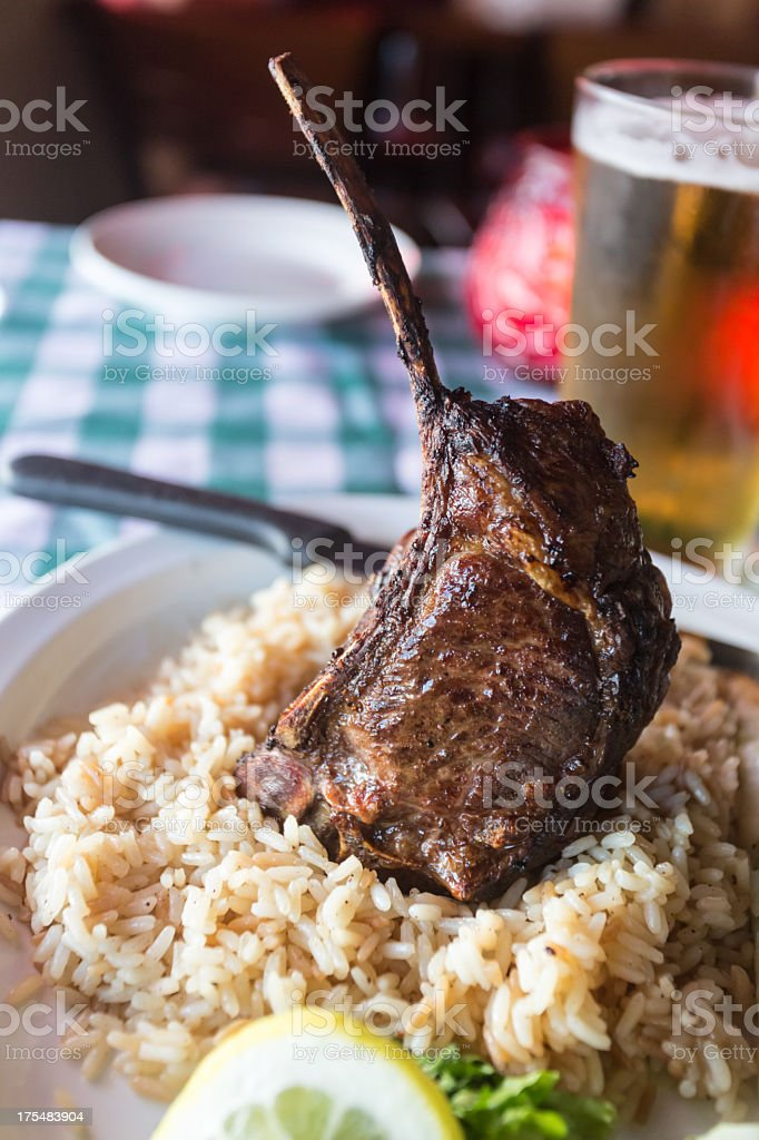 Rack of Lamb with Greek Rice and Beer stock photo
