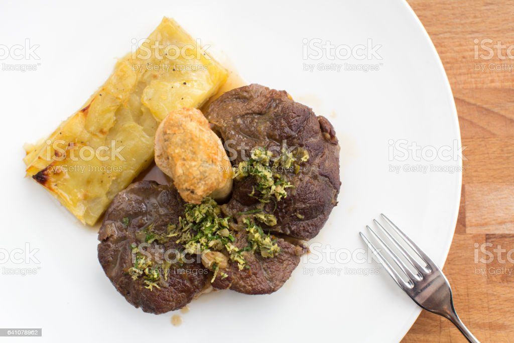 Rack of Lamb with peas and potatoes stock photo