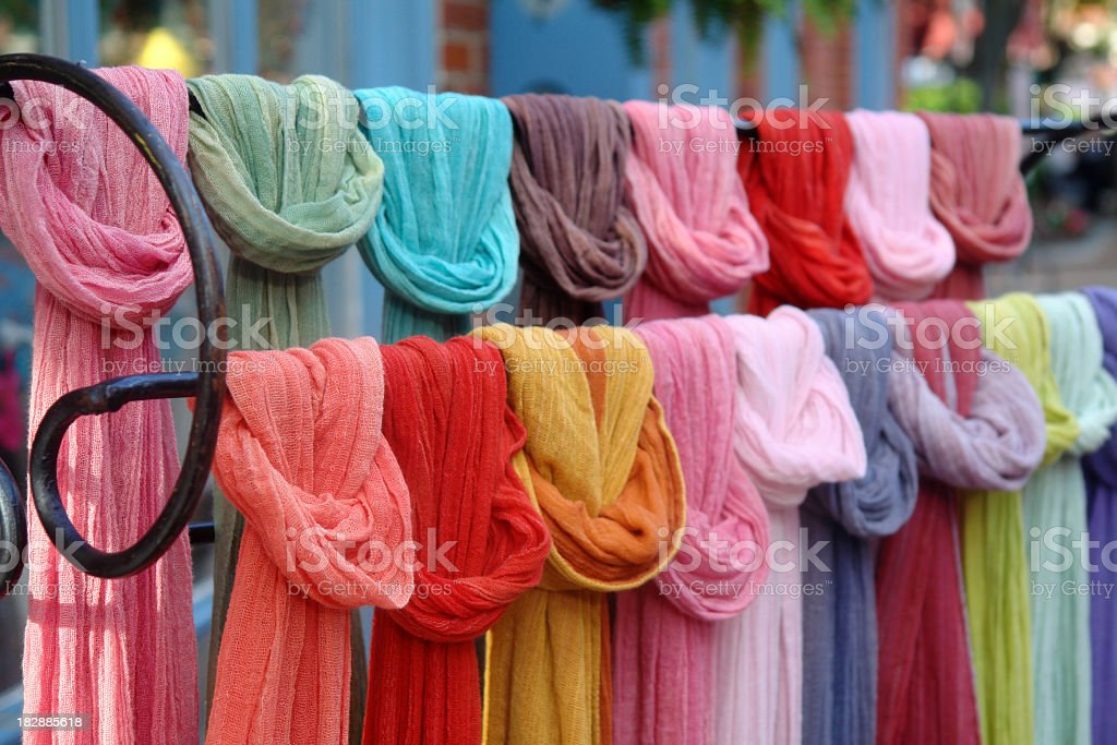 Rack of multicolored hip scarves stock photo