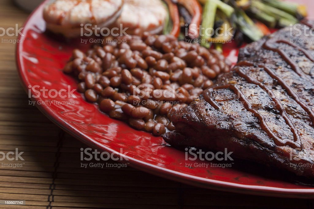 Rack of Ribs, Baked Beans, Grilled Vegetables and Shrimp royalty-free stock photo