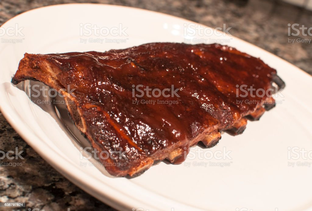 Rack of ribs on a plate stock photo
